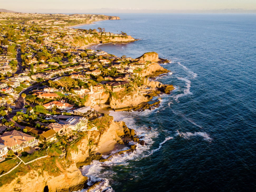 Drone view of luxury real estate buildings at the coast of Laguna Beach, California, USA